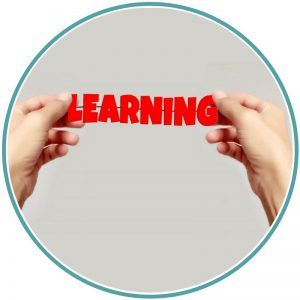 """Duas mãos segurando mostrando a palavra """"Learning"""""""